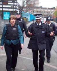 Harriet Harman fellow nazi (in bullet proof vest) in her local unsafe area