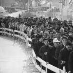 happy comrades queuing